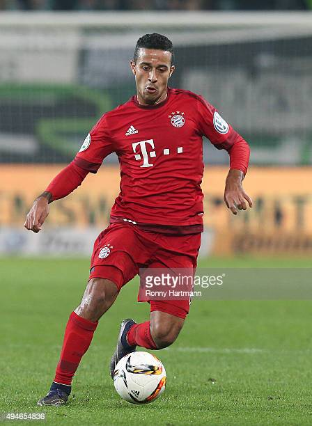 Thiago of Muenchen runs with the ball during the DFB Cup second round match between VfL Wolfsburg and FC Bayern Muenchen at Volkswagen Arena on...