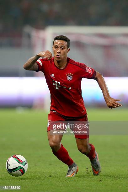 Thiago of Muenchen runs with the ball during the international friendly match between FC Bayern Muenchen and Inter Milan of the Audi Football Summit...