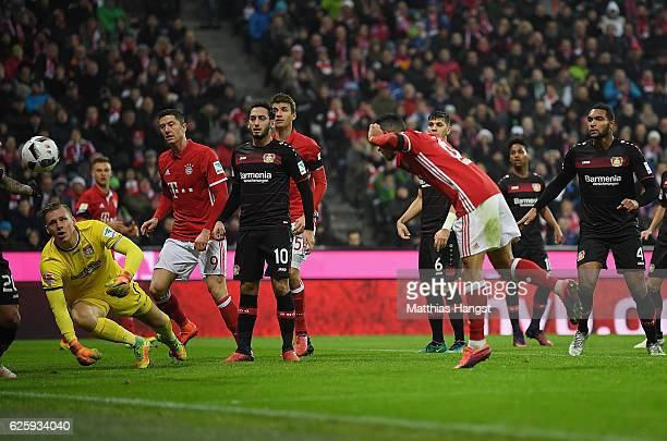 Thiago of Muenchen scores his team's first goal past Goalkeeper Bernd Leno of Leverkusen during the Bundesliga match between Bayern Muenchen and...