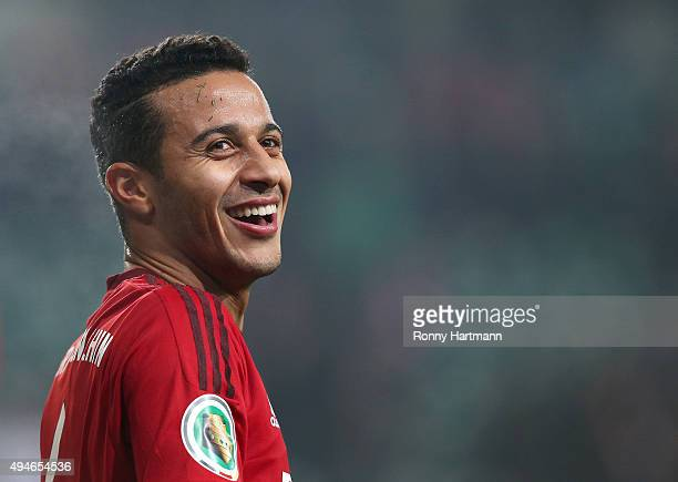 Thiago of Muenchen smiles during the DFB Cup second round match between VfL Wolfsburg and FC Bayern Muenchen at Volkswagen Arena on October 27 2015...