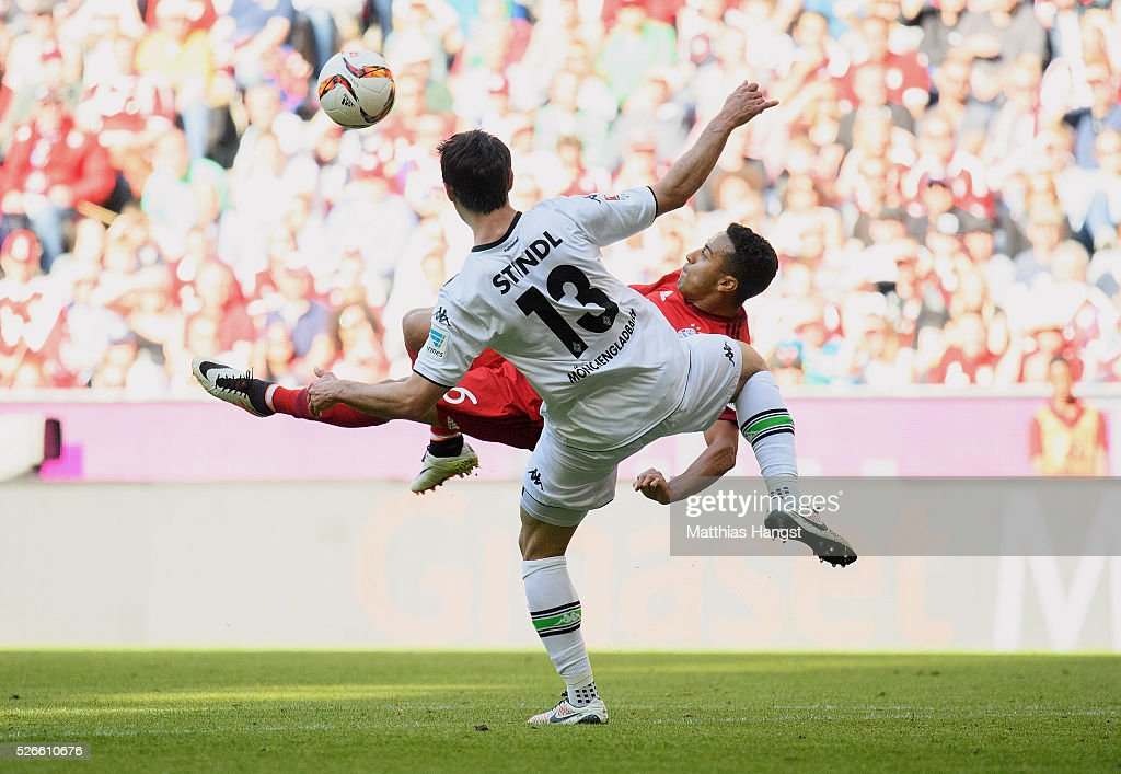 Thiago of Muenchen tries an overheadkick next to <a gi-track='captionPersonalityLinkClicked' href=/galleries/search?phrase=Lars+Stindl&family=editorial&specificpeople=654295 ng-click='$event.stopPropagation()'>Lars Stindl</a> of Gladbach during the Bundesliga match between FC Bayern Muenchen and Borussia Moenchengladbach at Allianz Arena on April 30, 2016 in Munich, Germany.