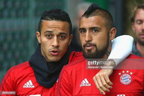 Thiago of Muenchen walks in for the warm up with his team mate Arturo Vidal for the Bundesliga match between SV Werder Bremen and FC Bayern Muenchen...
