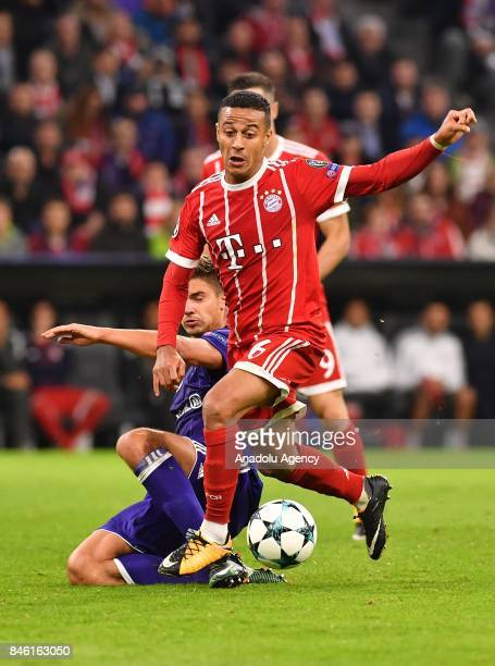 Thiago of Munich and Leander Dendoncker of Anderlecht vie for the ball during the UEFA Champions League match between FC Bayern Munich and RSC...