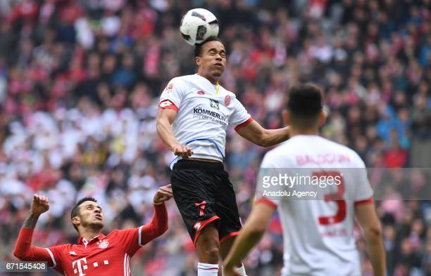 Thiago of Munich and Robin Quaison of Mainz vie for the ball during the Bundesliga soccer match between FC Bayern Munich and Mainz 05 at the Allianz...