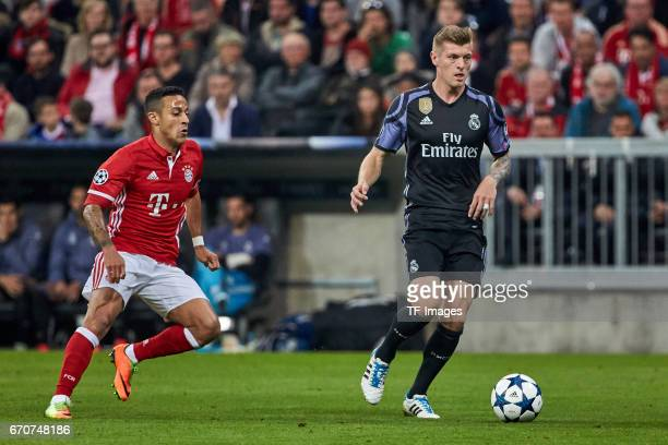 Thiago of Munich and Toni Kroos of Real Madrid battle for the ball during the UEFA Champions League Quarter Final first leg match between FC Bayern...