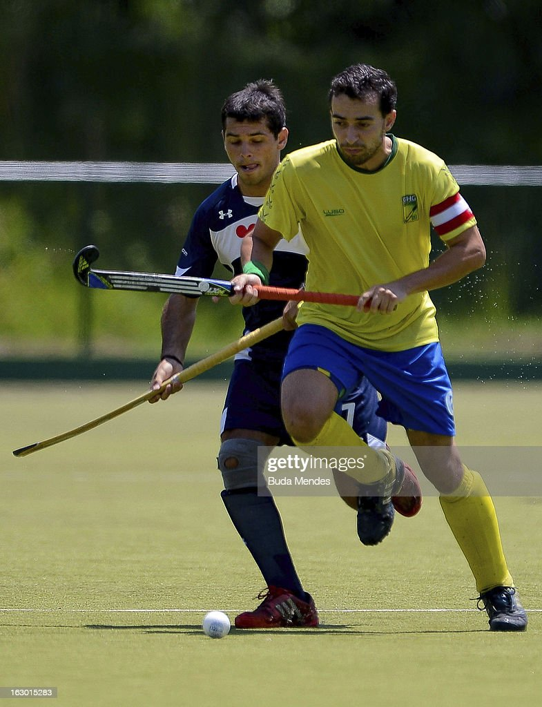 Thiago Pacheco (R) of Brazil in action during a match between Brazil and Chile as part of the Hockey World League - Round 2 at Complexo Esportivo de Deodoro on March 03, 2013 in Rio de Janeiro, Brazil.
