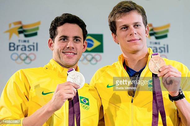 Thiago Pereira and Cesar Cielo of Brazil winners of t silver and bronze medal in Mens Swimming show their medals during a press conference at Casa...