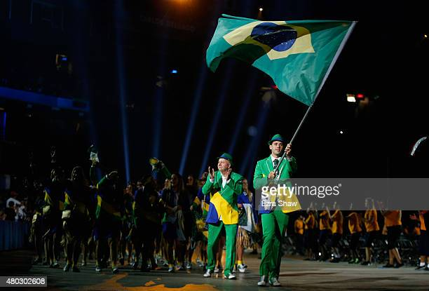 Thiago Pereira carries the flag for Brazil during the Opening Ceremony for the Toronto 2015 Pan Am Games at Rogers Centre on July 10 2015 in Toronto...