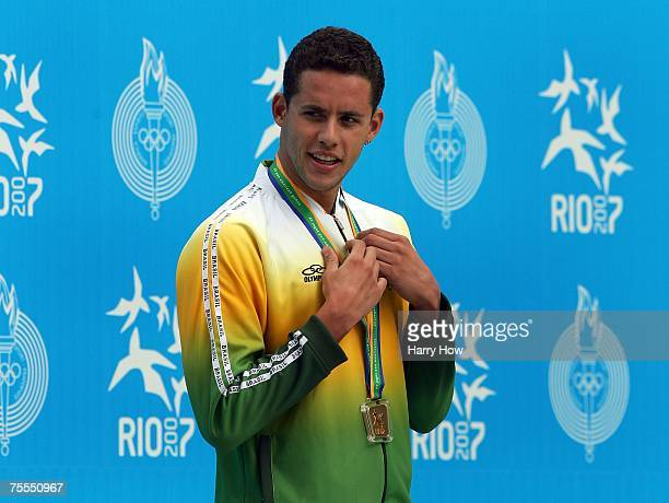 Thiago Pereira of Brazil smiles on the podium with his gold medal in the 200m Backstroke final during the medal ceremony at the 2007 XV Pan American...