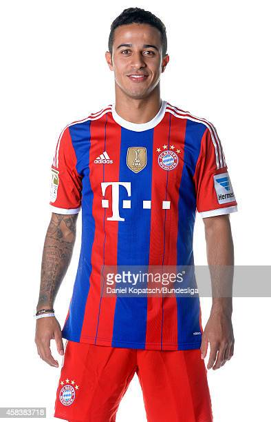 Thiago poses during the FC Bayern Muenchen Team Presentation for DFL on August 9 2014 in Munich Germany