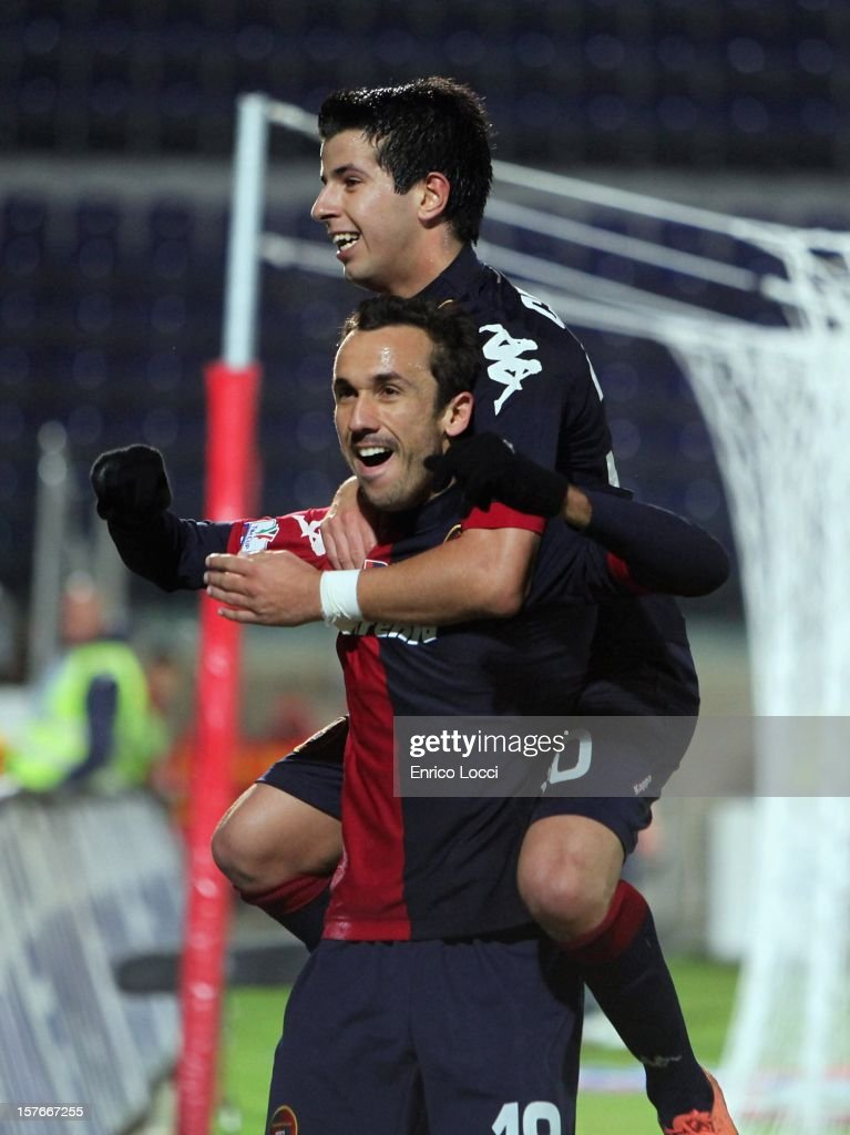<a gi-track='captionPersonalityLinkClicked' href=/galleries/search?phrase=Thiago+Ribeiro&family=editorial&specificpeople=5668762 ng-click='$event.stopPropagation()'>Thiago Ribeiro</a> (L) of Cagliari celebrates with Pablo Ceppelini after scoring a goal during the TIM Cup match between Cagliari Calcio and Pescara at Stadio Is Arenas on December 5, 2012 in Cagliari, Italy.