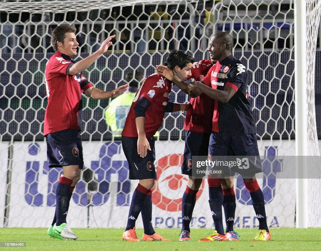 <a gi-track='captionPersonalityLinkClicked' href=/galleries/search?phrase=Thiago+Ribeiro&family=editorial&specificpeople=5668762 ng-click='$event.stopPropagation()'>Thiago Ribeiro</a> (2nd R) of Cagliari celebrates with team-mates after scoring a goal during the TIM Cup match between Cagliari Calcio and Pescara at Stadio Is Arenas on December 5, 2012 in Cagliari, Italy.