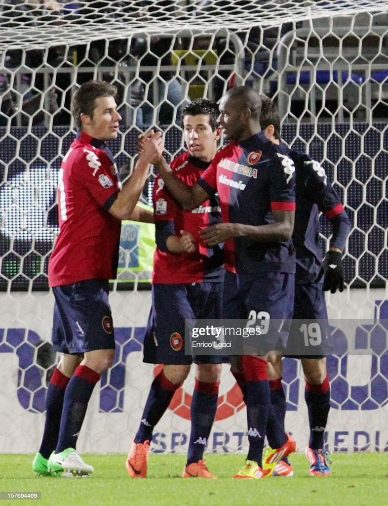 <a gi-track='captionPersonalityLinkClicked' href=/galleries/search?phrase=Thiago+Ribeiro&family=editorial&specificpeople=5668762 ng-click='$event.stopPropagation()'>Thiago Ribeiro</a> (R) of Cagliari celebrates with team-mates after scoring a goal during the TIM Cup match between Cagliari Calcio and Pescara at Stadio Is Arenas on December 5, 2012 in Cagliari, Italy.