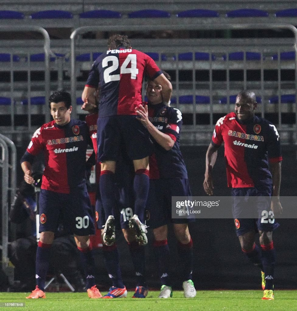 <a gi-track='captionPersonalityLinkClicked' href=/galleries/search?phrase=Thiago+Ribeiro&family=editorial&specificpeople=5668762 ng-click='$event.stopPropagation()'>Thiago Ribeiro</a> #19 of Cagliri celebraties with team-mates after scoring a goal during the TIM Cup match between Cagliari Calcio and Pescara at Stadio Is Arenas on December 5, 2012 in Cagliari, Italy.