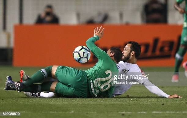 Thiago Ribeiro of Santos battles for the ball with Diego Renan of Chapecoense during the match between Santos and Chapecoense as a part of Campeonato...