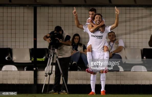 Thiago Ribeiro of Santos celebrates scoring the first goal with Rildo during the match between Santos and Atletico PR for the Brazilian Series A 2014...