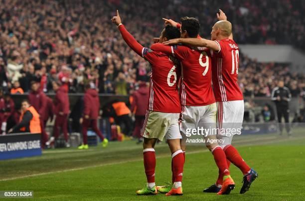 Thiago Robert Lewandowski and Arjen Robben of Munich celebrate during the UEFA Champions League round of 16 soccer match between FC Bayern Munich and...