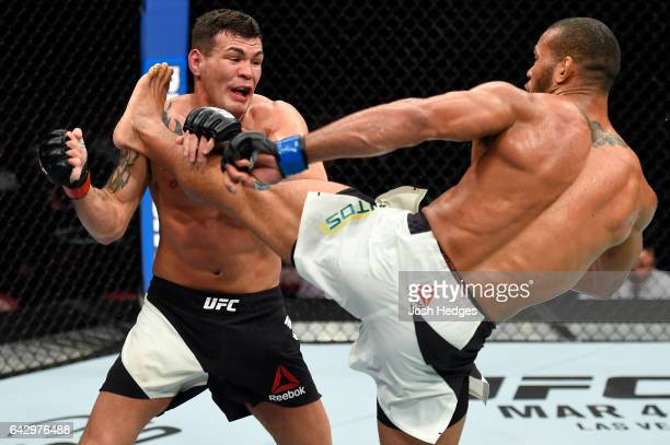 Thiago Santos of Brazil lands a kick to the head of Jack Marshman of South Wales in their middleweight fight during the UFC Fight Night event inside...