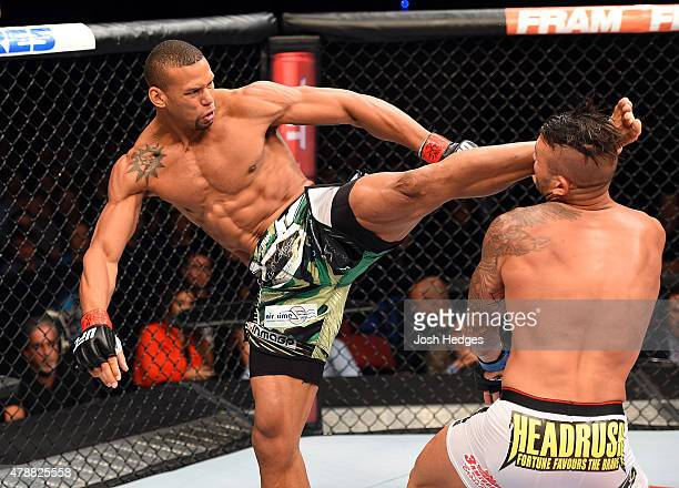 Thiago Santos of Brazil lands a kick to the head of Steve Bosse of Canada in their middleweight during the UFC Fight Night event at the Hard Rock...
