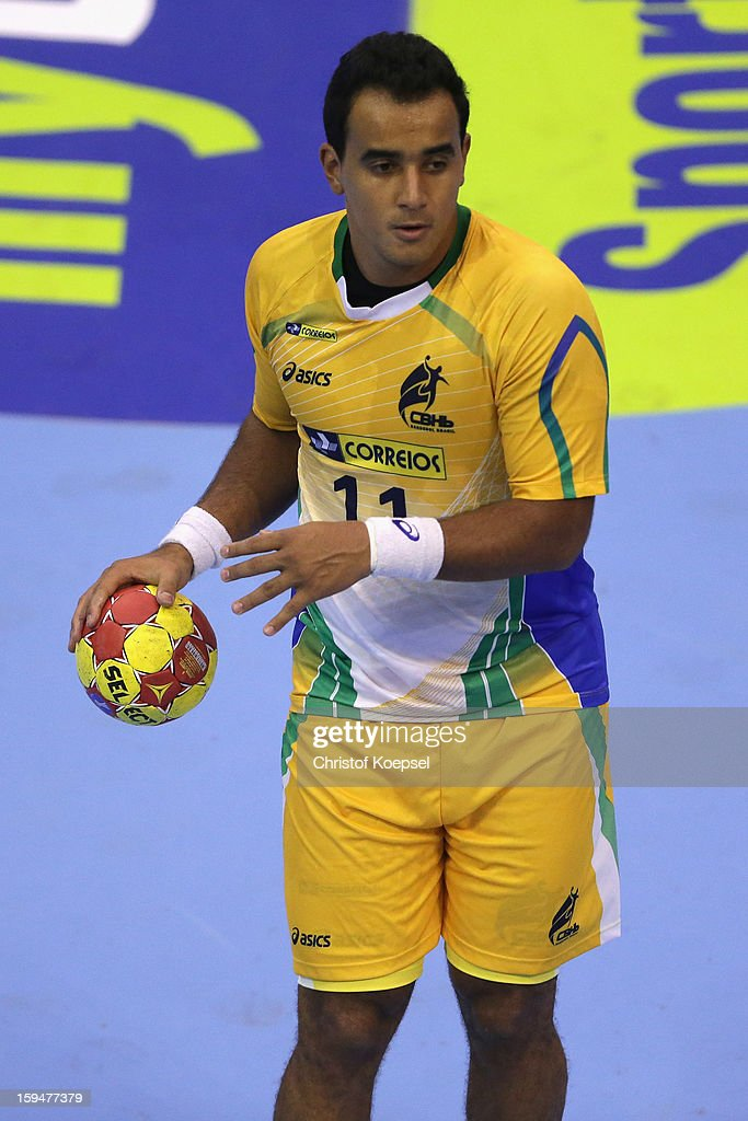 Thiago Santos of Brazil passes the ball during the premilary group A match between Brasil and Argentina and Montenegro at Palacio de Deportes de Granollers on January 13, 2013 in Granollers, Spain.