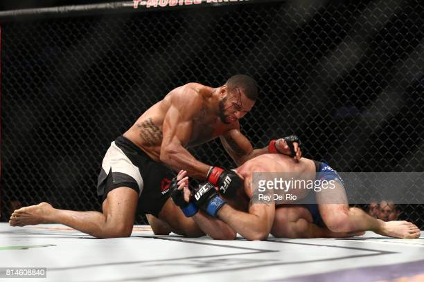 Thiago Santos punches Gerald Meerschaert in their middleweight bout during the UFC 213 event at TMobile Arena on July 9 2017 in Las Vegas Nevada