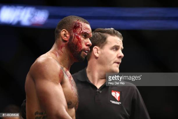 Thiago Santos stands in the Octagon between rounds against Gerald Meerschaert in their middleweight bout during the UFC 213 event at TMobile Arena on...