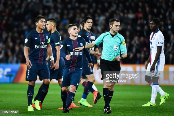 Thiago Silva and Marco Verratti of PSG talks with referee Clement Turpin during the French Ligue 1 match between Paris Saint Germain and Lyon at Parc...
