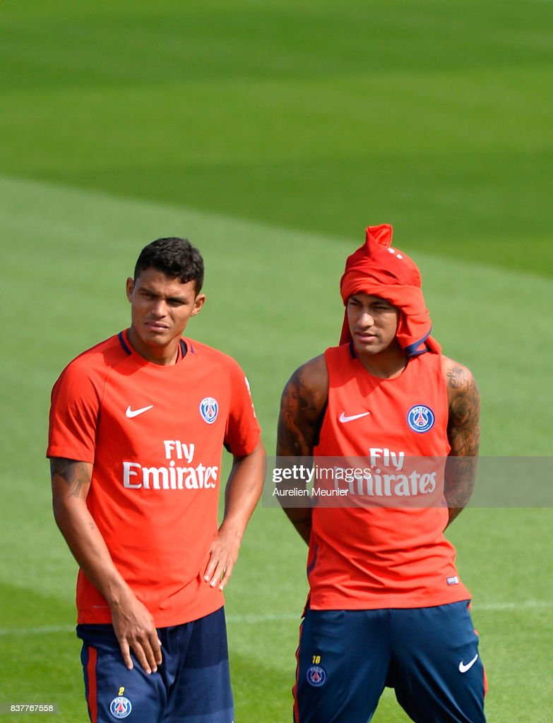 Thiago Silva and Neymar Jr of Paris Saint-Germain listen to the Coach before a Paris Saint-Germain training session at Centre Ooredoo on August 23, 2017 in Saint-Germain en Laye, Paris, France.