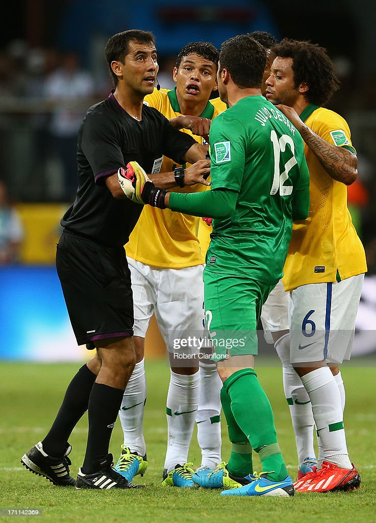 Thiago Silva (2L), Julio Cesar (2R) and Marcelo of Brazil (R) protest to referee Ravshan Irmatov as Giorgio Chiellini of Italy (not pictured) scores their second goal during the FIFA Confederations Cup Brazil 2013 Group A match between Italy and Brazil at Estadio Octavio Mangabeira (Arena Fonte Nova Salvador) on June 22, 2013 in Salvador, Brazil.