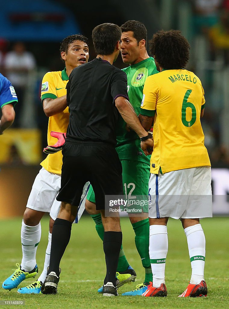 Thiago Silva (L), Julio Cesar (2R) and Marcelo of Brazil (R) protest to referee Ravshan Irmatov as Giorgio Chiellini of Italy (not pictured) scores their second goal during the FIFA Confederations Cup Brazil 2013 Group A match between Italy and Brazil at Estadio Octavio Mangabeira (Arena Fonte Nova Salvador) on June 22, 2013 in Salvador, Brazil.