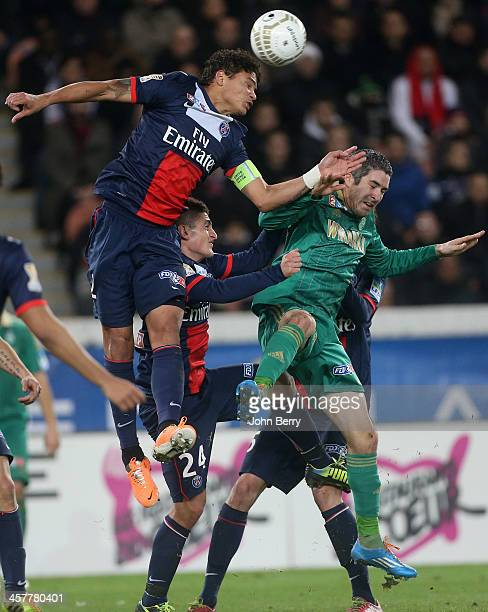 Thiago Silva Marco Verratti of PSG and Loic Perrin of SaintEtienne in action during the french Ligue Cup match between Paris SaintGermain FC and AS...