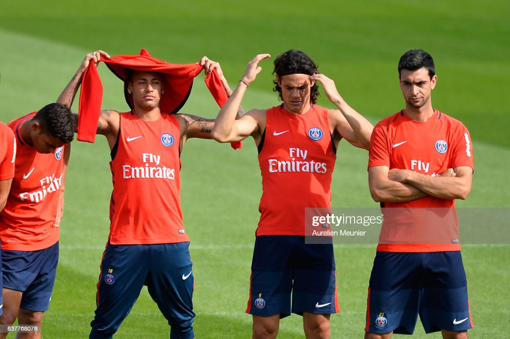 Thiago Silva, Neymar Jr, Edinson Cavani and Javier Pastore of Paris Saint-Germain listen to the Coach before a Paris Saint-Germain training session at Centre Ooredoo on August 23, 2017 in Saint-Germain en Laye, Paris, France.