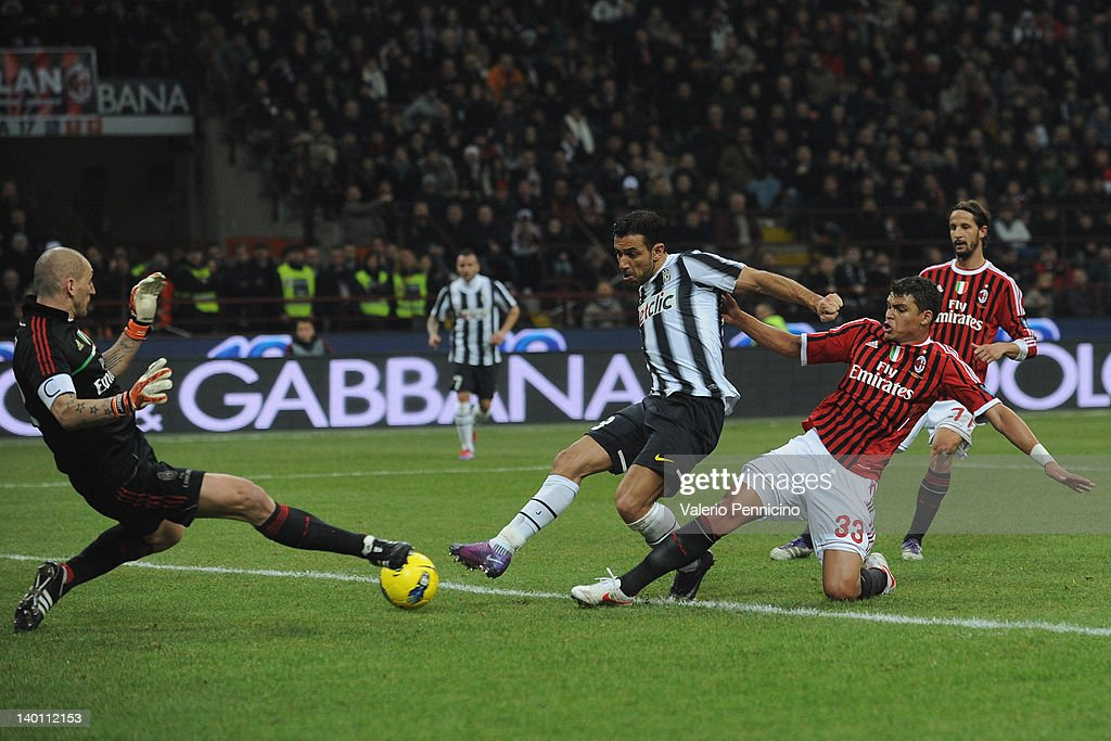 Thiago Silva (R) of AC Milan challenges Fabio Quagliarella of Juventus FC as he shoots toward goal during the Serie A match between AC Milan and Juventus FC at Stadio Giuseppe Meazza on February 25, 2012 in Milan, Italy.