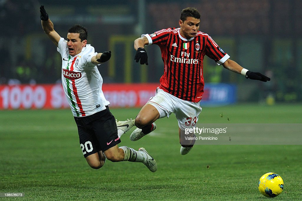 Thiago Silva (R) of AC Milan clashes with Simone Padoin of Juventus FC during the Tim Cup match between AC Milan and Juventus FC at Giuseppe Meazza Stadium on February 8, 2012 in Milan, Italy.