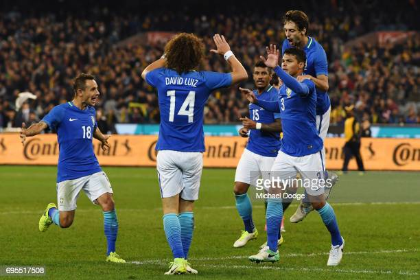 Thiago Silva of Brazil celebrates a goal with teammates during the Brasil Global Tour match between Australian Socceroos and Brazil at Melbourne...