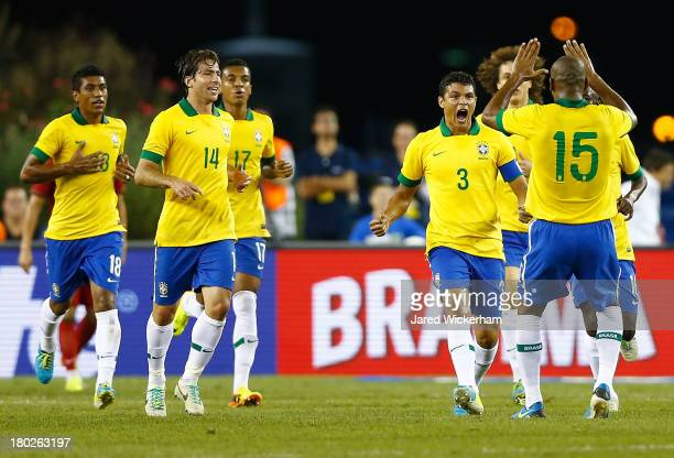 Thiago Silva of Brazil celebrates with teammate Maicon following his goal in the first half against Portugal during the international friendly match...