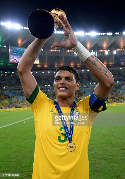 Thiago Silva of Brazil celebrates with the trophy at the end of the FIFA Confederations Cup Brazil 2013 Final match between Brazil and Spain at...