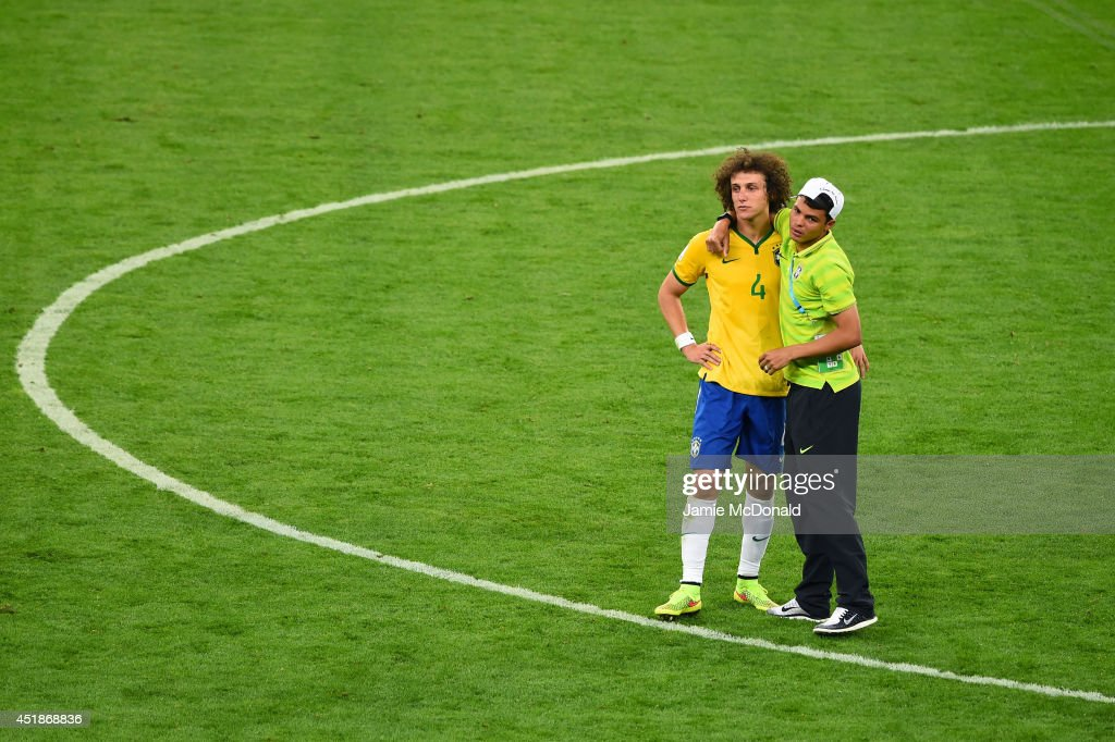 Thiago Silva of Brazil consoles <a gi-track='captionPersonalityLinkClicked' href=/galleries/search?phrase=David+Luiz&family=editorial&specificpeople=4133397 ng-click='$event.stopPropagation()'>David Luiz</a> after Germany's 7-1 victory during the 2014 FIFA World Cup Brazil Semi Final match between Brazil and Germany at Estadio Mineirao on July 8, 2014 in Belo Horizonte, Brazil.