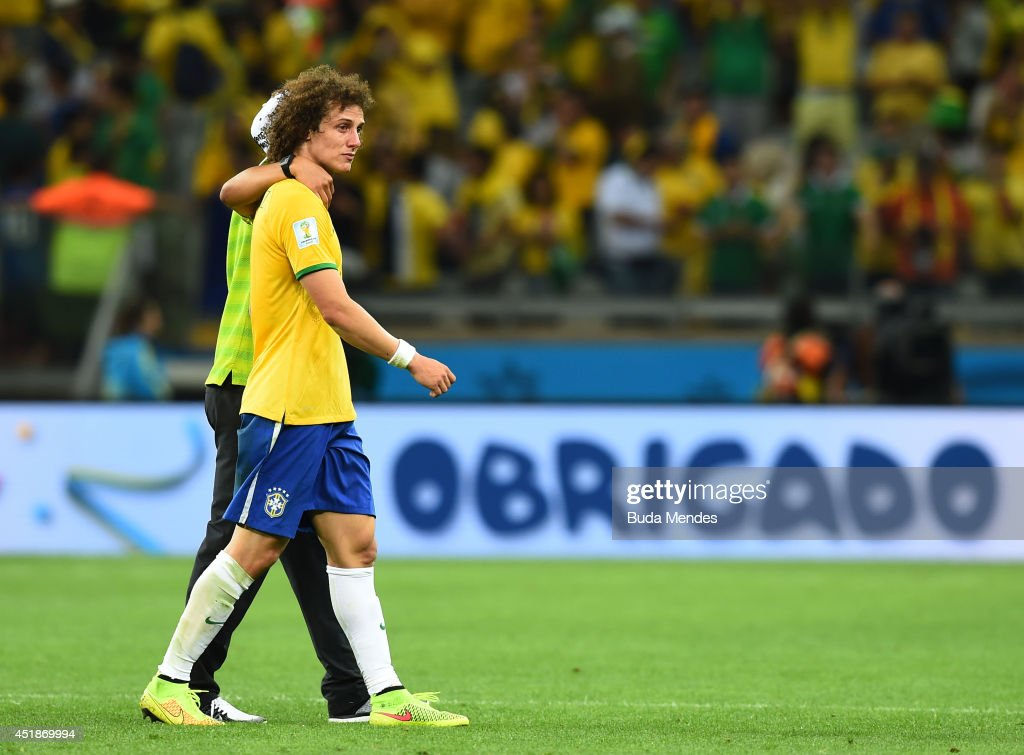 Thiago Silva of Brazil consoles David Luiz after Germany's 7-1 victory during the 2014 FIFA World Cup Brazil Semi Final match between Brazil and Germany at Estadio Mineirao on July 8, 2014 in Belo Horizonte, Brazil.
