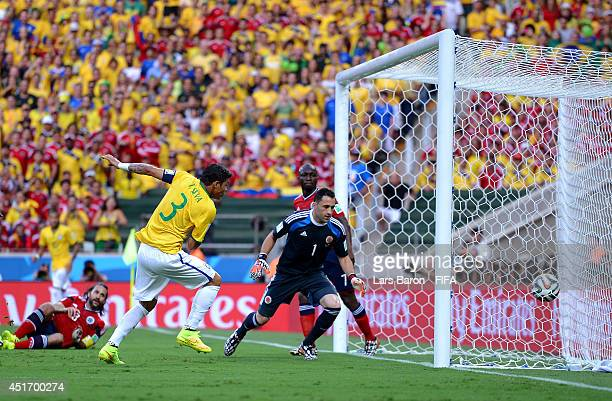 Thiago Silva of Brazil scores his team's first goa during the 2014 FIFA World Cup Brazil Quarter Final match between Brazil and Colombia at Estadio...