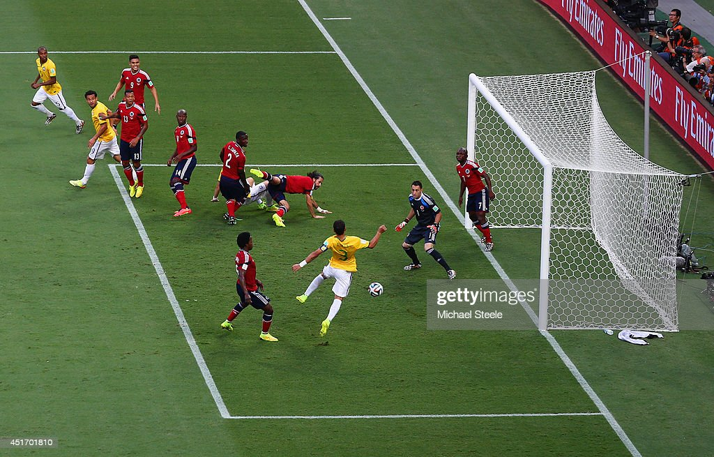 Thiago Silva of Brazil scores his team's first goal past <a gi-track='captionPersonalityLinkClicked' href=/galleries/search?phrase=David+Ospina&family=editorial&specificpeople=4104267 ng-click='$event.stopPropagation()'>David Ospina</a> of Colombia during the 2014 FIFA World Cup Brazil Quarter Final match between Brazil and Colombia at Castelao on July 4, 2014 in Fortaleza, Brazil.
