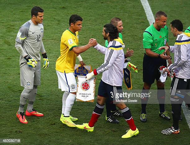 Thiago Silva of Brazil shakes hands with Mario Yepes of Colombia prior to the 2014 FIFA World Cup Brazil Quarter Final match between Brazil and...
