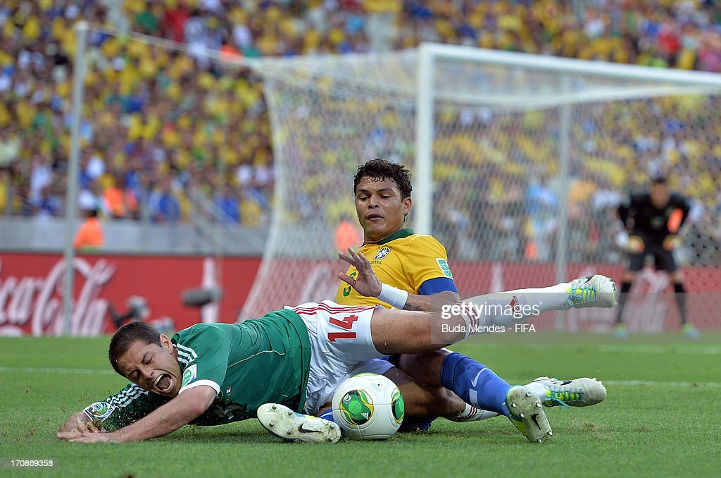 Thiago Silva of Brazil tangles with <a gi-track='captionPersonalityLinkClicked' href=/galleries/search?phrase=Javier+Hernandez+-+Soccer+Player&family=editorial&specificpeople=6733186 ng-click='$event.stopPropagation()'>Javier Hernandez</a> of Mexico during the FIFA Confederations Cup Brazil 2013 Group A match between Brazil and Mexico at Castelao on June 19, 2013 in Fortaleza, Brazil.