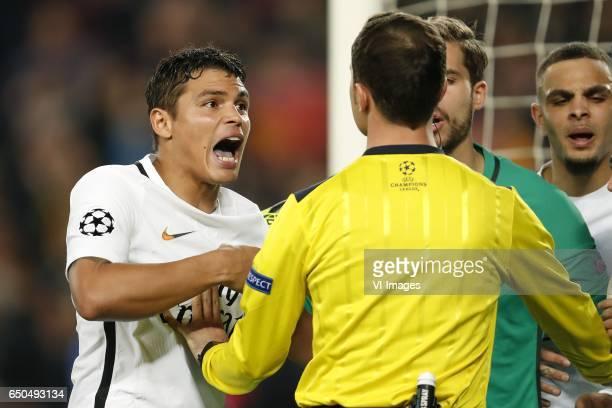 Thiago Silva of Paris SaintGermain 5th official Benjamin Brand goalkeeper Kevin Trapp of Paris SaintGermainduring the UEFA Champions League round of...