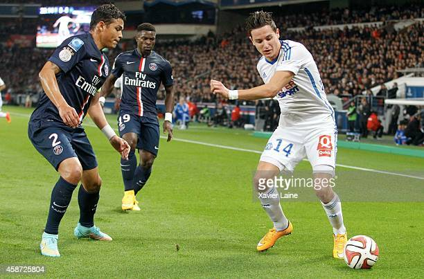 Thiago Silva of paris SaintGermain and Florian Thauvin of Olympique de marseille in action during the French Ligue 1 between Paris SaintGermain FC...