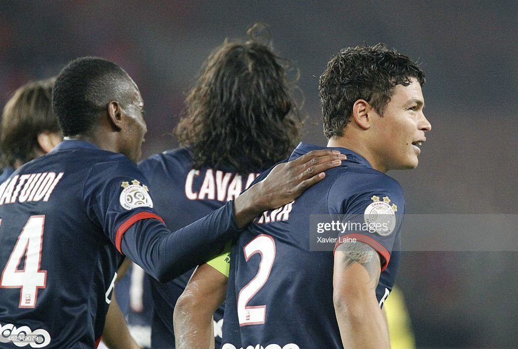 Thiago Silva of Paris Saint-Germain celebrate his goal with <a gi-track='captionPersonalityLinkClicked' href=/galleries/search?phrase=Blaise+Matuidi&family=editorial&specificpeople=801779 ng-click='$event.stopPropagation()'>Blaise Matuidi</a> (R)during the French Ligue 1 between Paris Saint-Germain FC and Olympique Lyonnais at Parc Des Princes on December 1, 2013 in Paris, France.