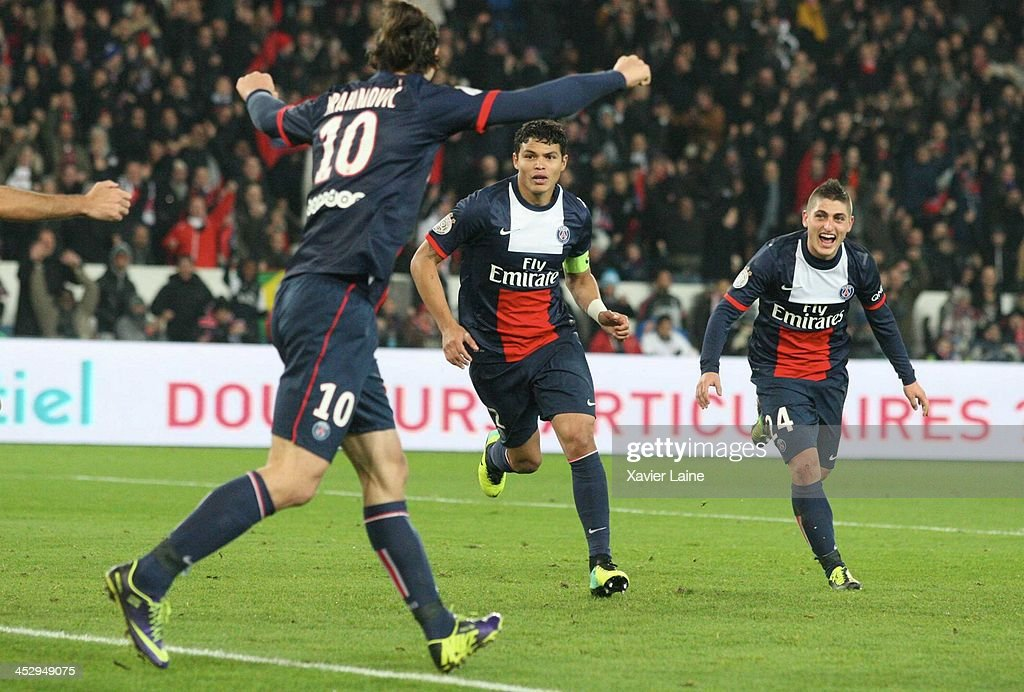 Thiago Silva of Paris Saint-Germain celebrate his goal with <a gi-track='captionPersonalityLinkClicked' href=/galleries/search?phrase=Zlatan+Ibrahimovic&family=editorial&specificpeople=206139 ng-click='$event.stopPropagation()'>Zlatan Ibrahimovic</a> (L) and <a gi-track='captionPersonalityLinkClicked' href=/galleries/search?phrase=Marco+Verratti&family=editorial&specificpeople=7256509 ng-click='$event.stopPropagation()'>Marco Verratti</a> (R) during the French Ligue 1 between Paris Saint-Germain FC and Olympique Lyonnais at Parc Des Princes on December 1, 2013 in Paris, France.