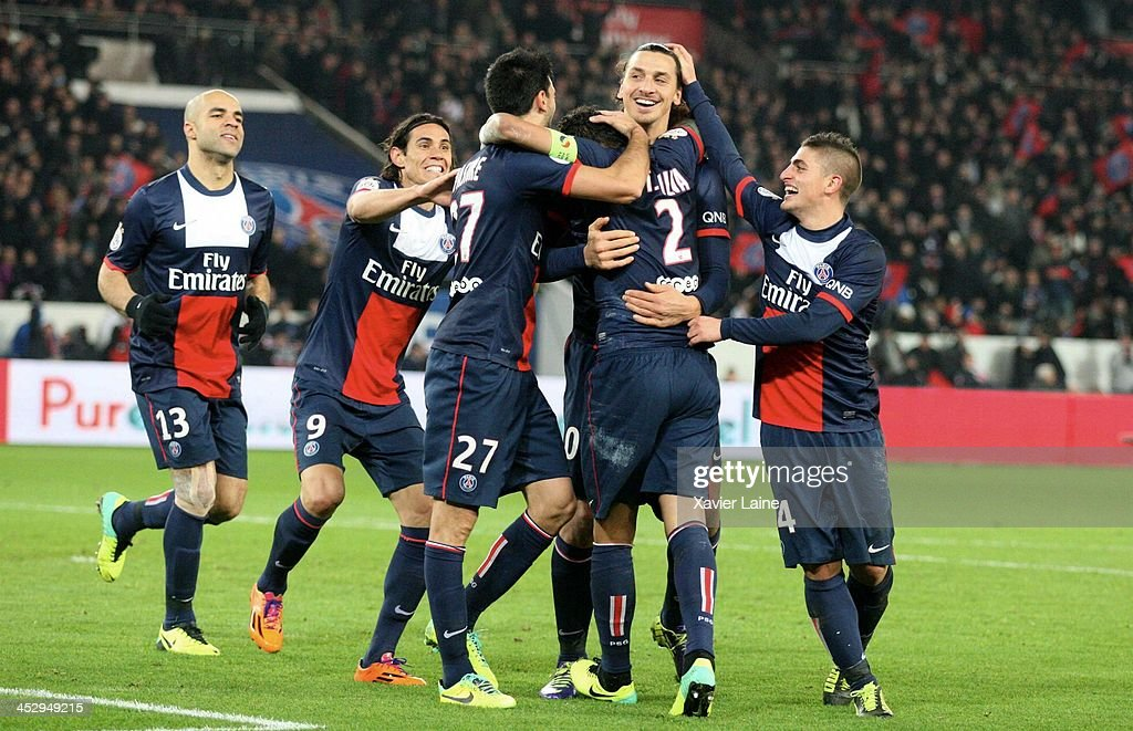 Thiago Silva of Paris Saint-Germain celebrate his goal with <a gi-track='captionPersonalityLinkClicked' href=/galleries/search?phrase=Zlatan+Ibrahimovic&family=editorial&specificpeople=206139 ng-click='$event.stopPropagation()'>Zlatan Ibrahimovic</a> and team-matte during the French Ligue 1 between Paris Saint-Germain FC and Olympique Lyonnais at Parc Des Princes on December 1, 2013 in Paris, France.