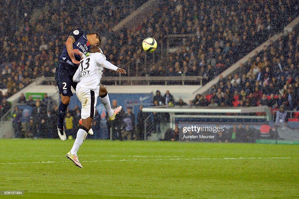 Thiago Silva of Paris Saint-Germain fights for the ball during the Ligue 1 match between Paris Saint-Germain and Stade Rennais at Parc des Princes on April 29, 2016 in Paris, France.