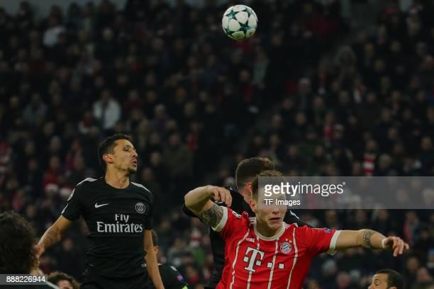 Thiago Silva of Paris SaintGermain Julian Draxler of Paris SaintGermain and Niklas Suele of Bayern Muenchen battle for the ball during the UEFA...